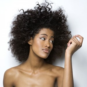 rby-woman-looking-at-hair-de-300x300