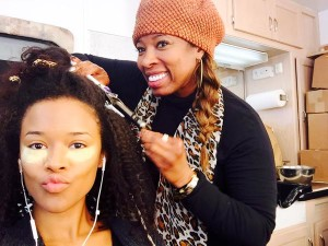 Serayah on set getting styled